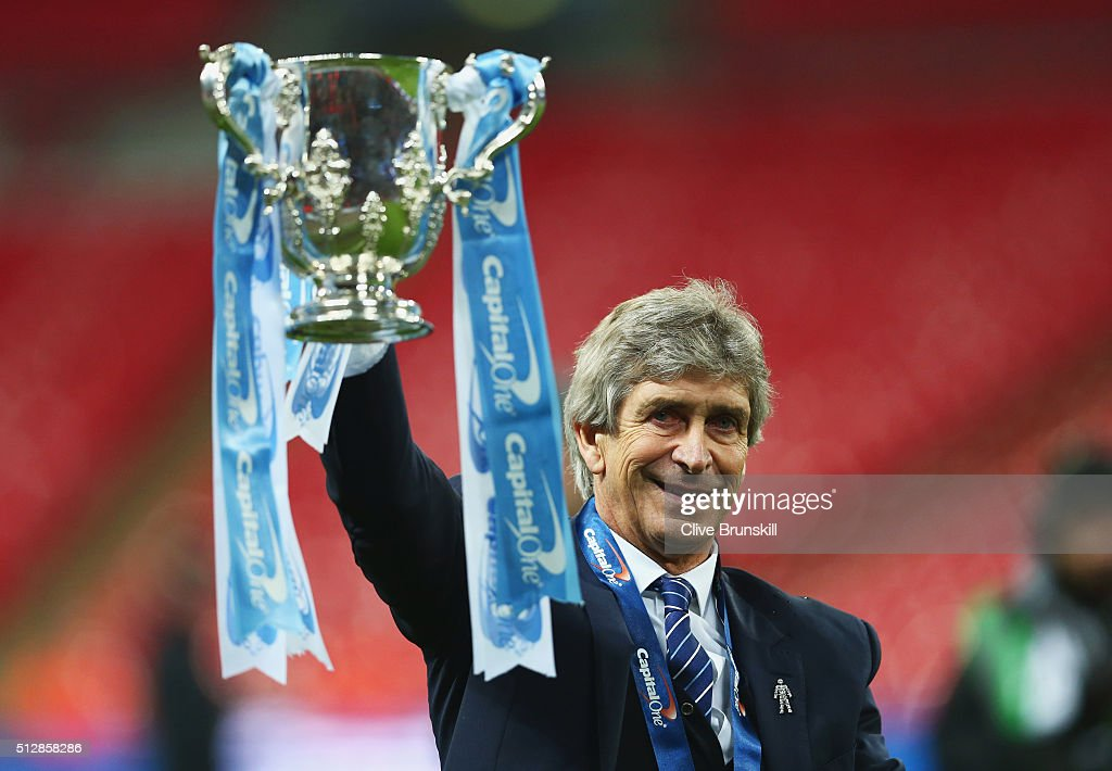 Manuel Pellegrini manager of Manchester City celebrates victory with the trophy after the Capital One Cup Final match between Liverpool and Manchester City at Wembley Stadium on February 28, 2016 in London, England. Manchester City win 3-1 on penalties.