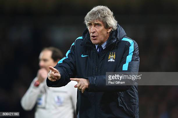 Manuel Pellegrini manager of Manchester City gestures during the Barclays Premier League match between West Ham United and Manchester City at the...