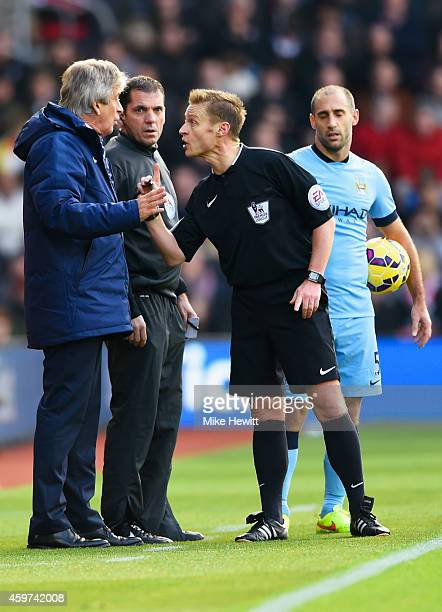 Manuel Pellegrini manager of Manchester City in discussion with referee Mike Jones during the Barclays Premier League match between Southampton and...