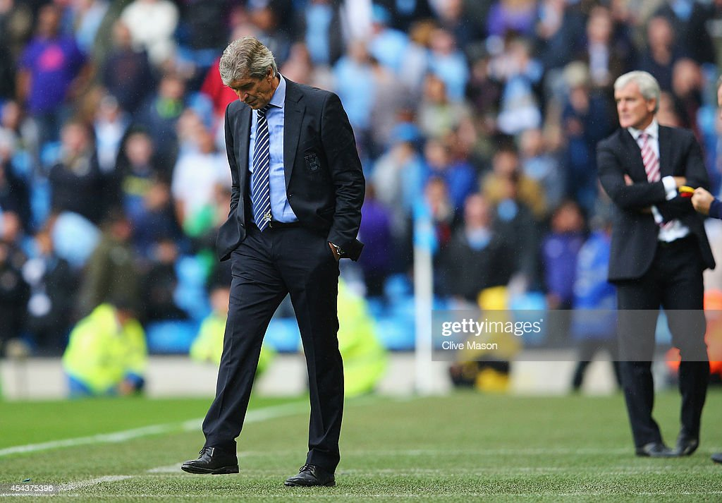 <a gi-track='captionPersonalityLinkClicked' href=/galleries/search?phrase=Manuel+Pellegrini&family=editorial&specificpeople=673553 ng-click='$event.stopPropagation()'>Manuel Pellegrini</a>, manager of Manchester City looks dejected with <a gi-track='captionPersonalityLinkClicked' href=/galleries/search?phrase=Mark+Hughes+-+Welsh+Soccer+Manager&family=editorial&specificpeople=206223 ng-click='$event.stopPropagation()'>Mark Hughes</a>, manager of Stoke City during the Barclays Premier League match between Manchester City and Stoke City at Etihad Stadium on August 30, 2014 in Manchester, England.