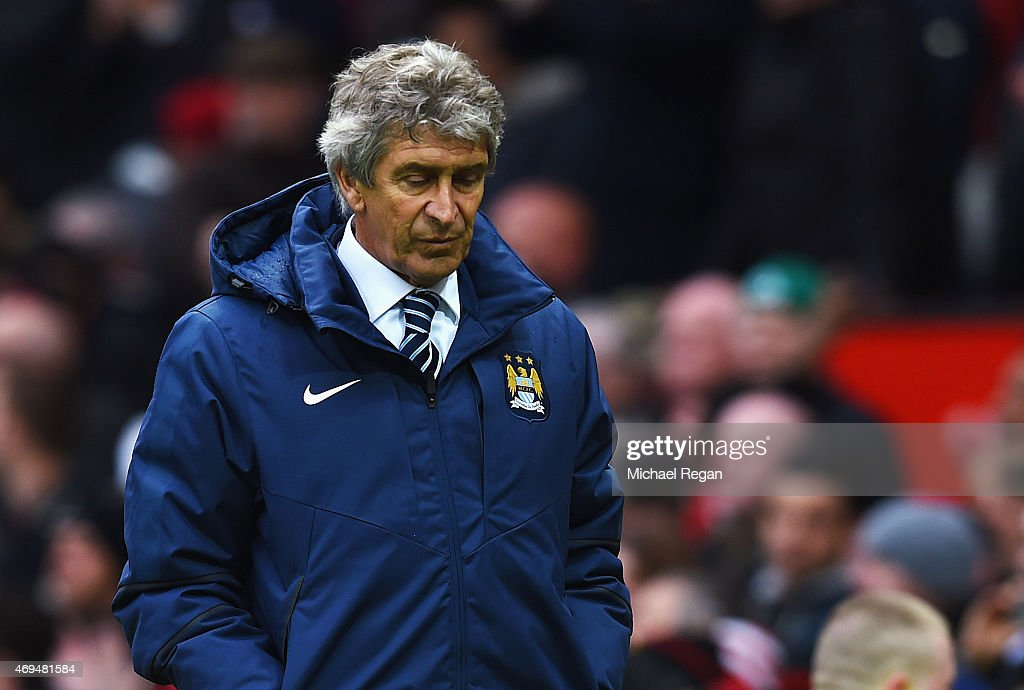 <a gi-track='captionPersonalityLinkClicked' href=/galleries/search?phrase=Manuel+Pellegrini&family=editorial&specificpeople=673553 ng-click='$event.stopPropagation()'>Manuel Pellegrini</a> manager of Manchester City looks depsondetn in defeat after the Barclays Premier League match between Manchester United and Manchester City at Old Trafford on April 12, 2015 in Manchester, England.