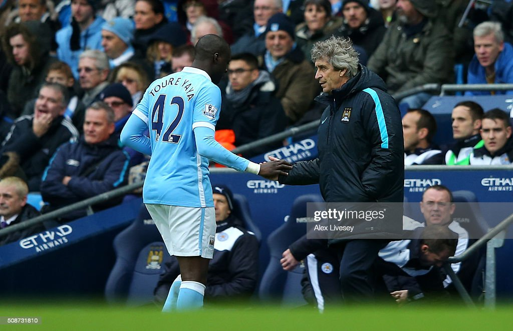 <a gi-track='captionPersonalityLinkClicked' href=/galleries/search?phrase=Manuel+Pellegrini&family=editorial&specificpeople=673553 ng-click='$event.stopPropagation()'>Manuel Pellegrini</a> (R), manager of Manchester City shakes hands with <a gi-track='captionPersonalityLinkClicked' href=/galleries/search?phrase=Yaya+Toure&family=editorial&specificpeople=550817 ng-click='$event.stopPropagation()'>Yaya Toure</a> (L) as he substitutes during the Barclays Premier League match between Manchester City and Leicester City at the Etihad Stadium on February 6, 2016 in Manchester, England.