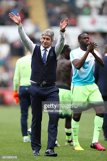 Manuel Pellegrini manager of Manchester City waves to fans after the Barclays Premier League match between Swansea City and Manchester City at the...