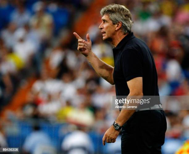 Manuel Pellegrini of Real Madrid issues instructions to his players during the Peace Cup match between Real Madrid and Liga Deportiva Universitaria...