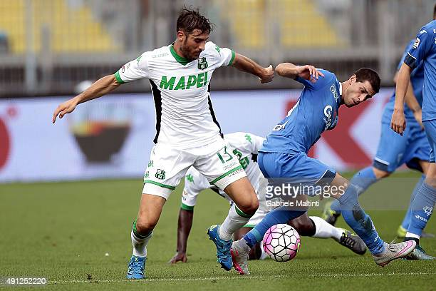 Manuel Piucciarelli of Empoli FC battles for the ball with Federico Peluso of US Sassuolo Calcio during the Serie A match between Empoli FC and US...