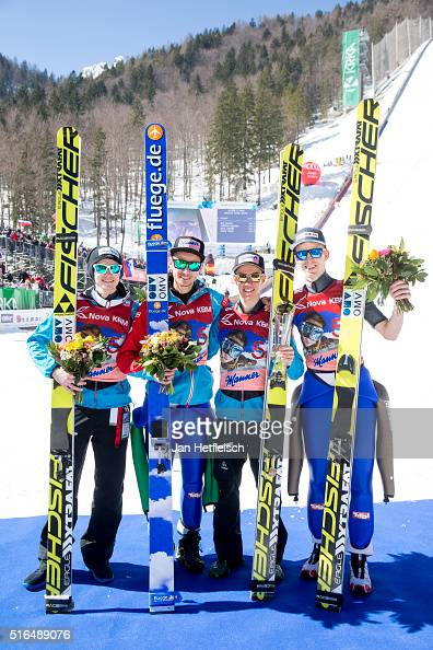Manuel Poppinger Manuel Fettner Stefan Kraft Michael Hayboeck of Austria pose for a picture after winning the third place of flying hill team...