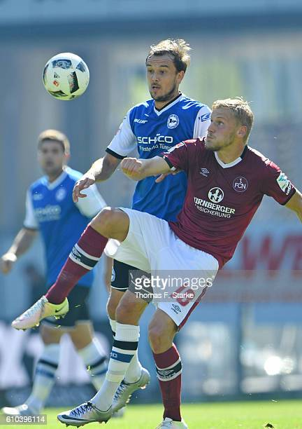 Manuel Prietl of Bielefeld and Hanno Behrens of Nuernberg fight for the ball during the Second Bundesliga match between DSC Arminia Bielefeld and 1...