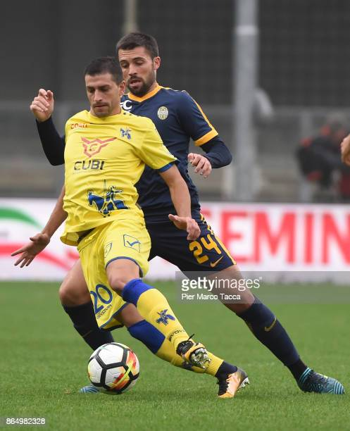 Manuel Pucciarelli of AC Chievo Verona competes for the ball with Daniel Bessa of Hellas Verona during the Serie A match between AC Chievo Verona and...