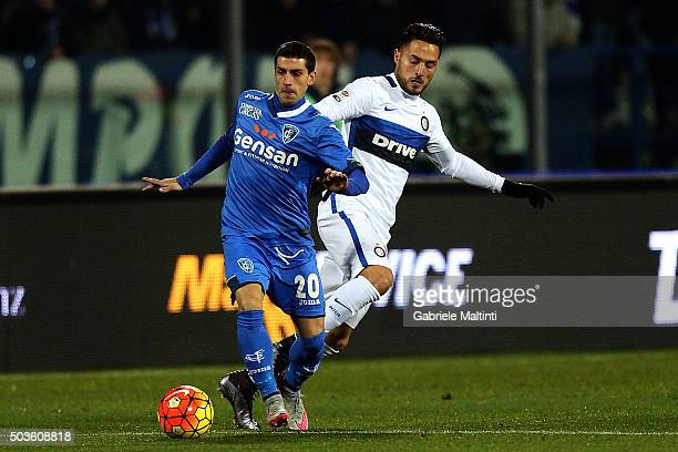 Manuel Pucciarelli of Empoli FC battles for the ball with Danilo D'Ambrosio of FC Internazionale Milano during the Serie A match between Empoli FC...