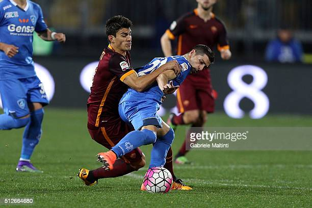 Manuel Pucciarelli of Empoli FC battles for the ball with Diego Perotti of AS Roma during the Serie A match between Empoli FC and AS Roma at Stadio...