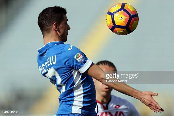 Manuel Pucciarelli of Empoli FC battles for the ball with Diego Laxalt of Genoa CFC during the Serie A match between Empoli FC and Genoa CFC at...