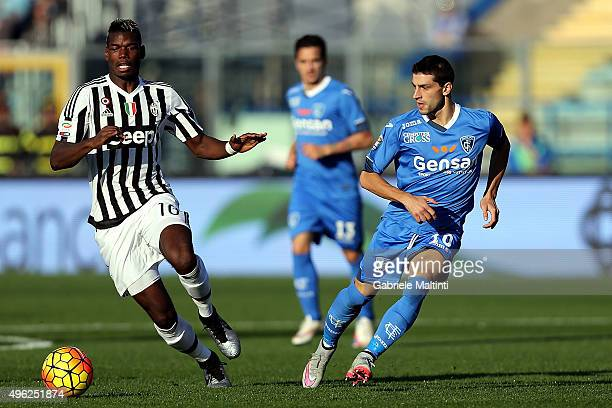 Manuel Pucciarelli of Empoli FC battles for the ball with Paul Pogba of Juventus FC during the Serie A match between Empoli FC and Juventus FC at...