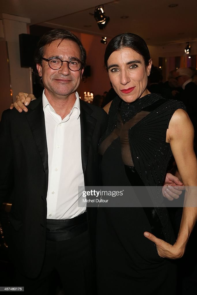 Manuel Puig and Bianca Li attend the Annual Charity Dinner Hosted By The AEM Association Children Of The World For Rwanda on December 17, 2013 in Paris, France.