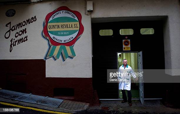Manuel Revilla stands outside his small familyrun Quintin Revilla jamon Iberico business in the town of Guijuelo on December 14 2012 near Salamanca...