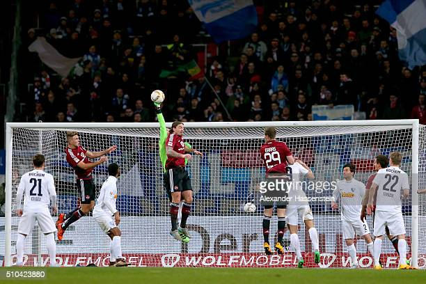 Manuel Riemann keeper of Bochum safes the ball against Dave Bulthuis of Nuernberg during the Second Bundesliga match between 1 FC Nuernberg and VfL...