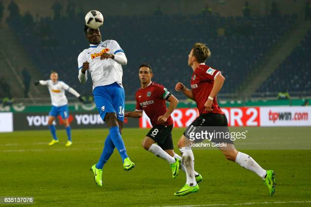 Manuel Schmiedebach and Felix Klaus of Hannover challenges Peniel Mlapa of Bochum during the Second Bundesliga match between Hannover 96 and VfL...