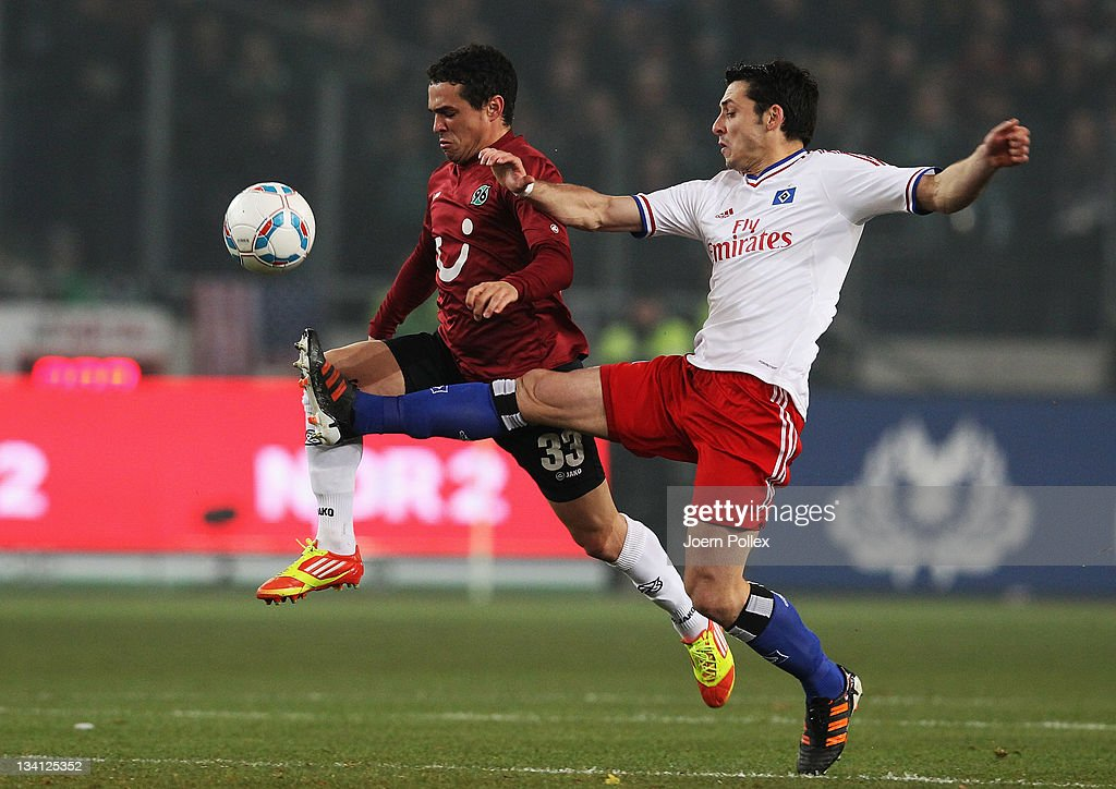 Manuel Schmiedebach (R) of Hannover and Gojko Kacar of Hamburg battle for the ball during the Bundesliga match between Hannover 96 and Hamburger SV at AWD Arena on November 26, 2011 in Hanover, Germany.