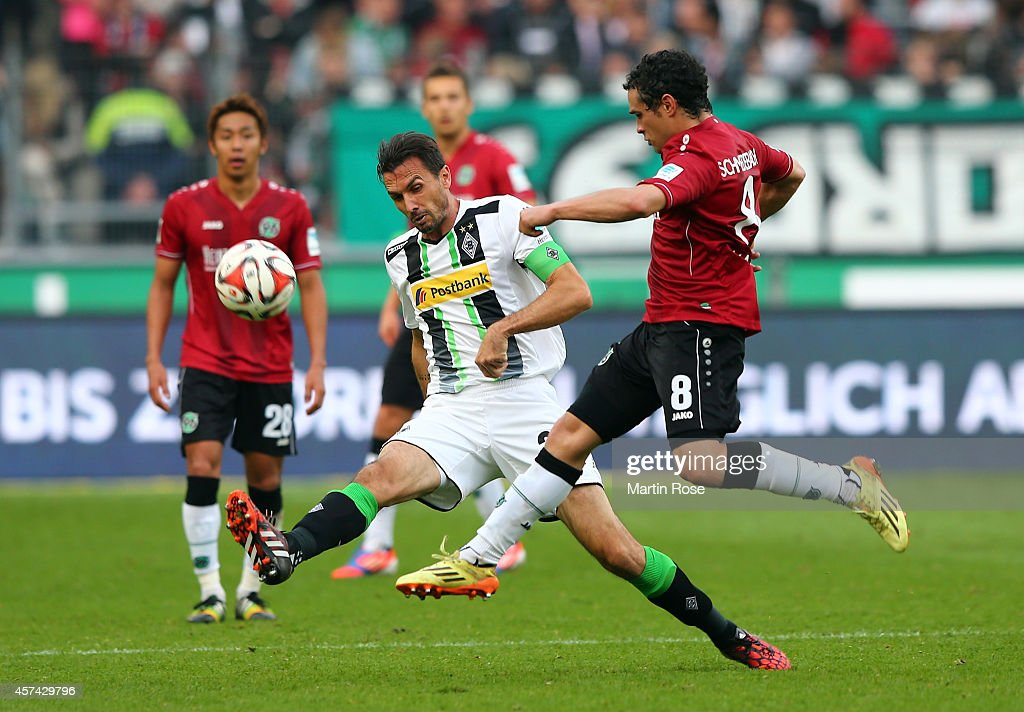 Manuel Schmiedebach of Hannover and Martin Stranzl of Gladbach battles for the ball during the Bundesliga match between Hannover 96 and Borussia...