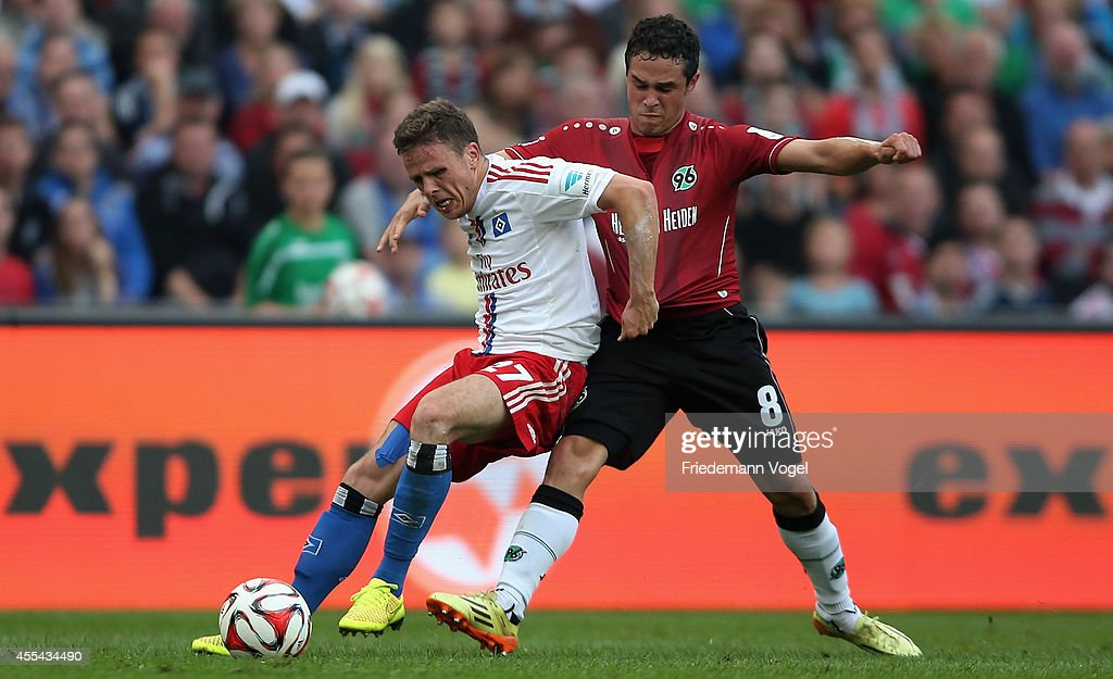 Manuel Schmiedebach of Hannover and Nicolai Mueller of Hamburg battle for the ball during the Bundesliga match between Hannover 96 and Hamburger SV...