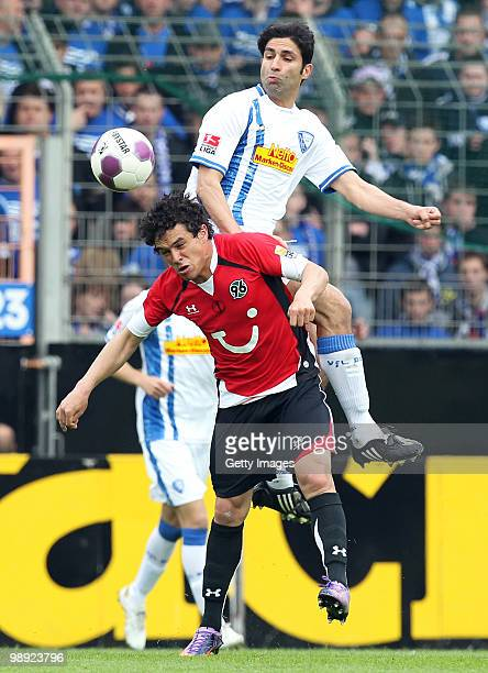 Manuel Schmiedebach of Hannover and Vahid Hashemian of Bochum jump for a header during the Bundesliga match between VfL Bochum and Hannover 96 at...