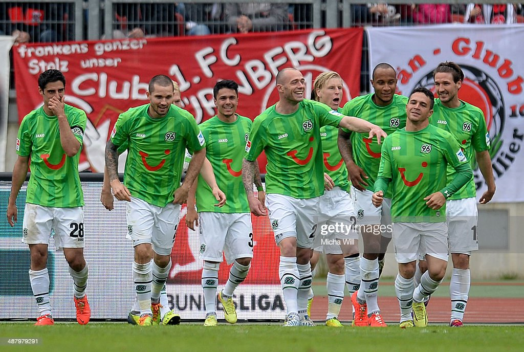 Manuel Schmiedebach (2nd R) of Hannover celebrates with team-mates after scoring his team's second goal during the Bundesliga match between 1. FC Nuernberg and Hannover 96 at Grundig Stadium on May 3, 2014 in Nuremberg, Germany.