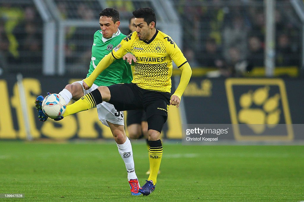 Manuel Schmiedebach of Hannover challenges Ilkay Guendogan of Dortmund during the Bundesliga match between Borussia Dortmund and Hannover 96 at Signal Iduna Park on February 26, 2012 in Dortmund, Germany.