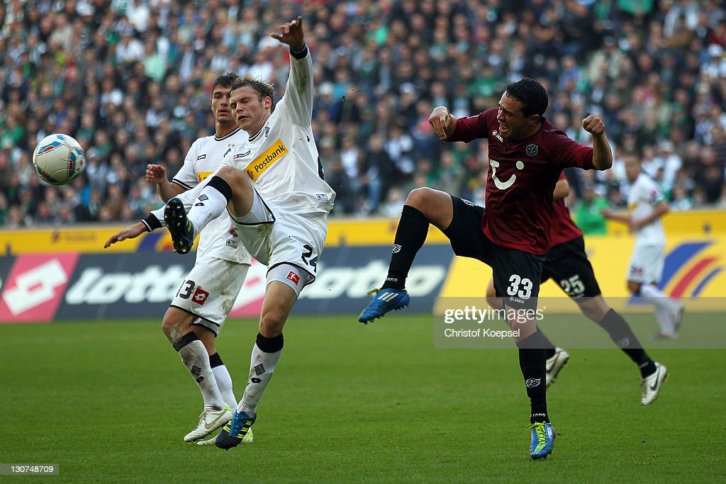 Manuel Schmiedebach of Hannover (R) challenges Tony Jantschke of Moenchengladbach (L) during the Bundesliga match between Borussia Moenchengladbach and Hannover 96 at Borussia Park Stadium on October 29, 2011 in Moenchengladbach, Germany.