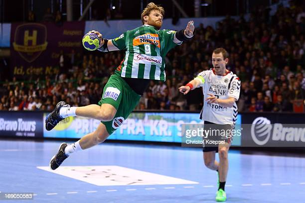 Manuel Spaeth of Goeppingen scores a goal annd Jakob Thoustrup of Holstebro follos him during the EHF Cup Semi Final match between Tvis Holstebro and...