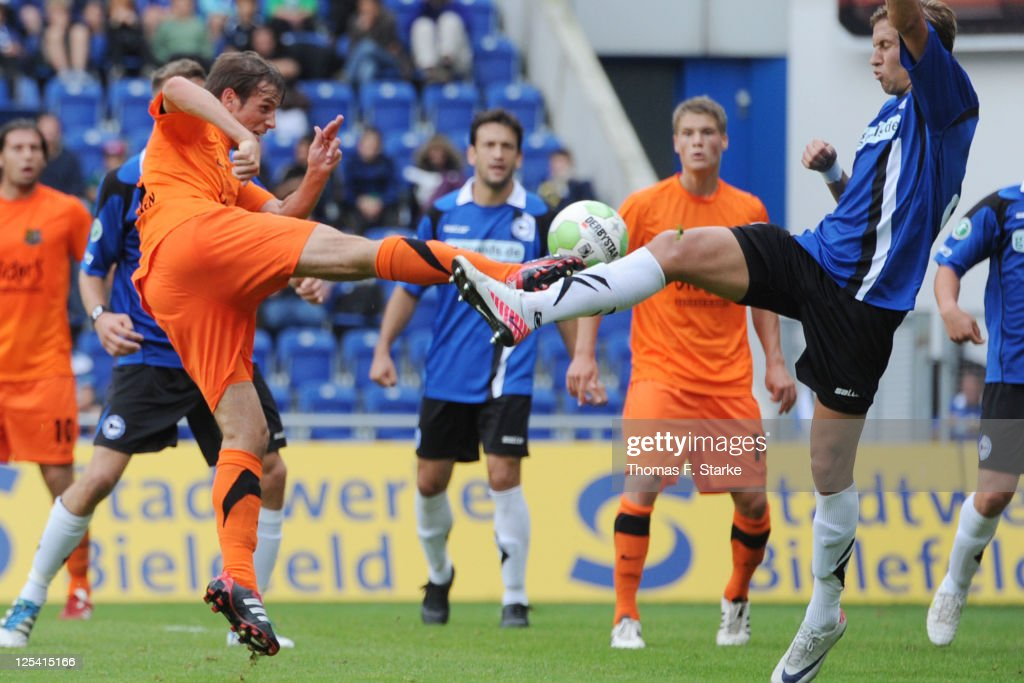 Manuel Stiefler (L) of Saarbruecken scores his teams first goal against <a gi-track='captionPersonalityLinkClicked' href=/galleries/search?phrase=Alexander+Kruek&family=editorial&specificpeople=5441553 ng-click='$event.stopPropagation()'>Alexander Kruek</a> (R) of Bielefeld during the Third League match between Arminia Bielefeld and 1. FC Saarbruecken at the Schueco Arena on September 17, 2011 in Bielefeld, Germany.