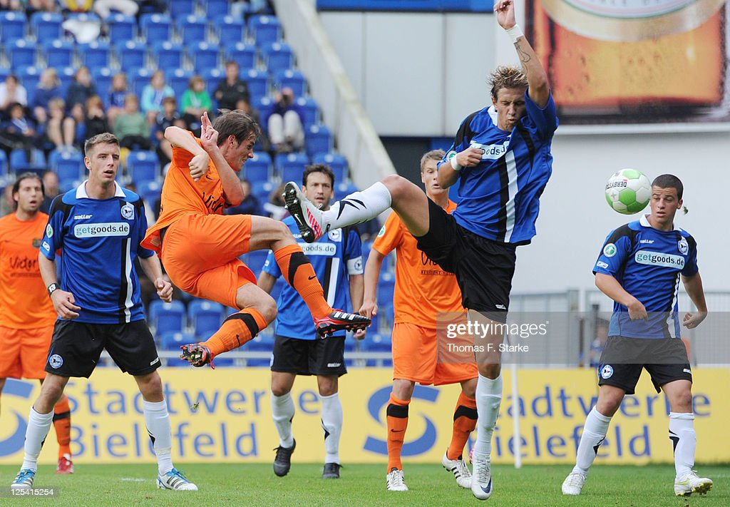Manuel Stiefler (3rd L) of Saarbruecken scores his teams first goal against <a gi-track='captionPersonalityLinkClicked' href=/galleries/search?phrase=Alexander+Kruek&family=editorial&specificpeople=5441553 ng-click='$event.stopPropagation()'>Alexander Kruek</a> (2nd R) of Bielefeld during the Third League match between Arminia Bielefeld and 1. FC Saarbruecken at the Schueco Arena on September 17, 2011 in Bielefeld, Germany.