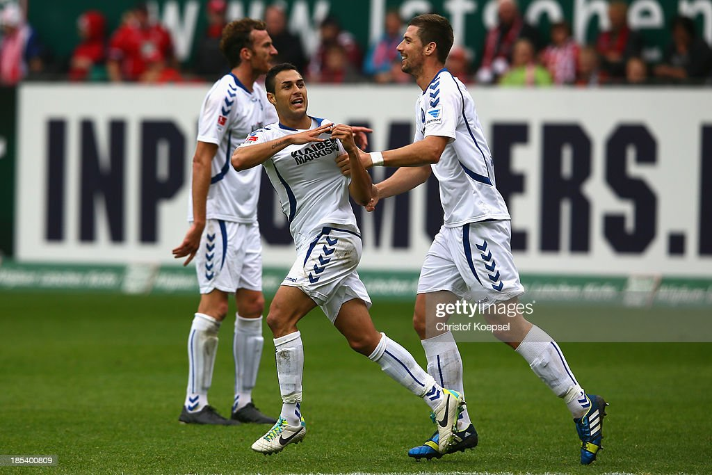 <a gi-track='captionPersonalityLinkClicked' href=/galleries/search?phrase=Manuel+Torres&family=editorial&specificpeople=2571412 ng-click='$event.stopPropagation()'>Manuel Torres</a> of Karlsruhe celebrates the first goal with Koen van der Biezen of Karlsruhe during the the Second Bundesliga match between 1. FC Kaiserslautern and Karlsruher SC at Fritz-Walter-Stadion on October 20, 2013 in Kaiserslautern, Germany.