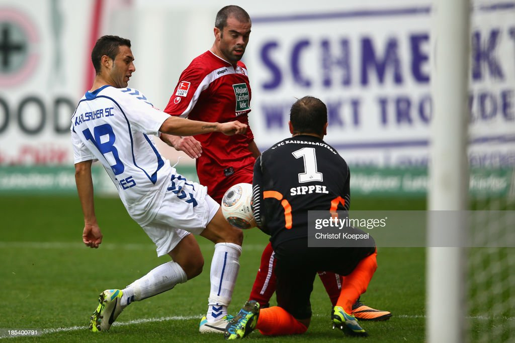 <a gi-track='captionPersonalityLinkClicked' href=/galleries/search?phrase=Manuel+Torres&family=editorial&specificpeople=2571412 ng-click='$event.stopPropagation()'>Manuel Torres</a> of Karlsruhe scores the first goal against <a gi-track='captionPersonalityLinkClicked' href=/galleries/search?phrase=Marc+Torrejon&family=editorial&specificpeople=4219506 ng-click='$event.stopPropagation()'>Marc Torrejon</a> and <a gi-track='captionPersonalityLinkClicked' href=/galleries/search?phrase=Tobias+Sippel&family=editorial&specificpeople=750795 ng-click='$event.stopPropagation()'>Tobias Sippel</a> of Kaiserslautern during the the Second Bundesliga match between 1. FC Kaiserslautern and Karlsruher SC at Fritz-Walter-Stadion on October 20, 2013 in Kaiserslautern, Germany.