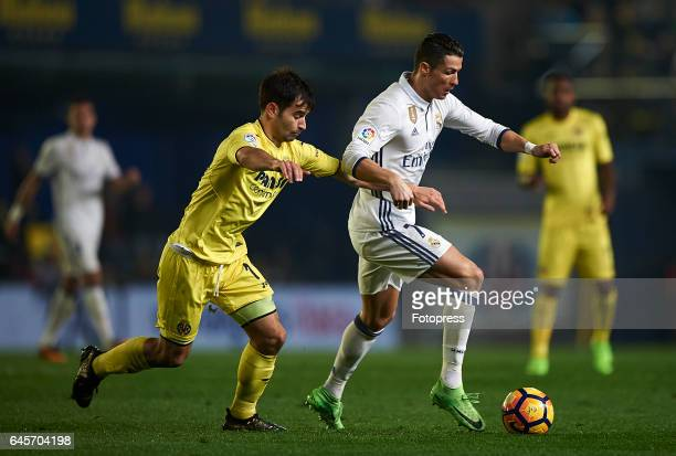 Manuel Trigueros of Villarreal competes for the ball with Cristiano Ronaldo of Real Madrid during the La Liga match between Villarreal CF and Real...