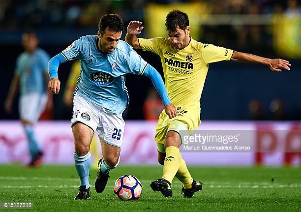 Manuel Trigueros of Villarreal competes for the ball with Giuseppe Rossi of Celta de Vigo during the La Liga match between Villarreal CF and Celta de...