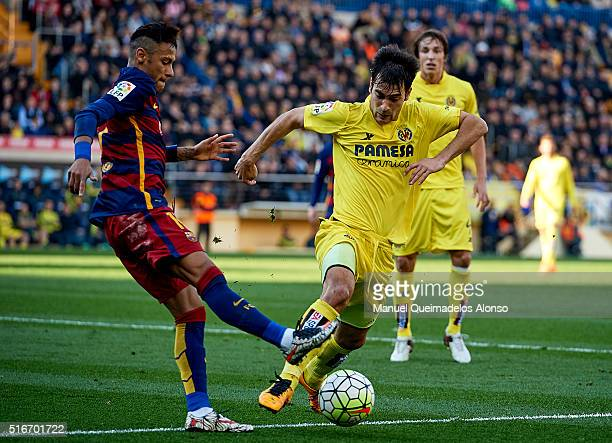 Manuel Trigueros of Villarreal is tackled by Neymar JR of Barcelona during the La Liga match between Villarreal CF and FC Barcelona at El Madrigal on...