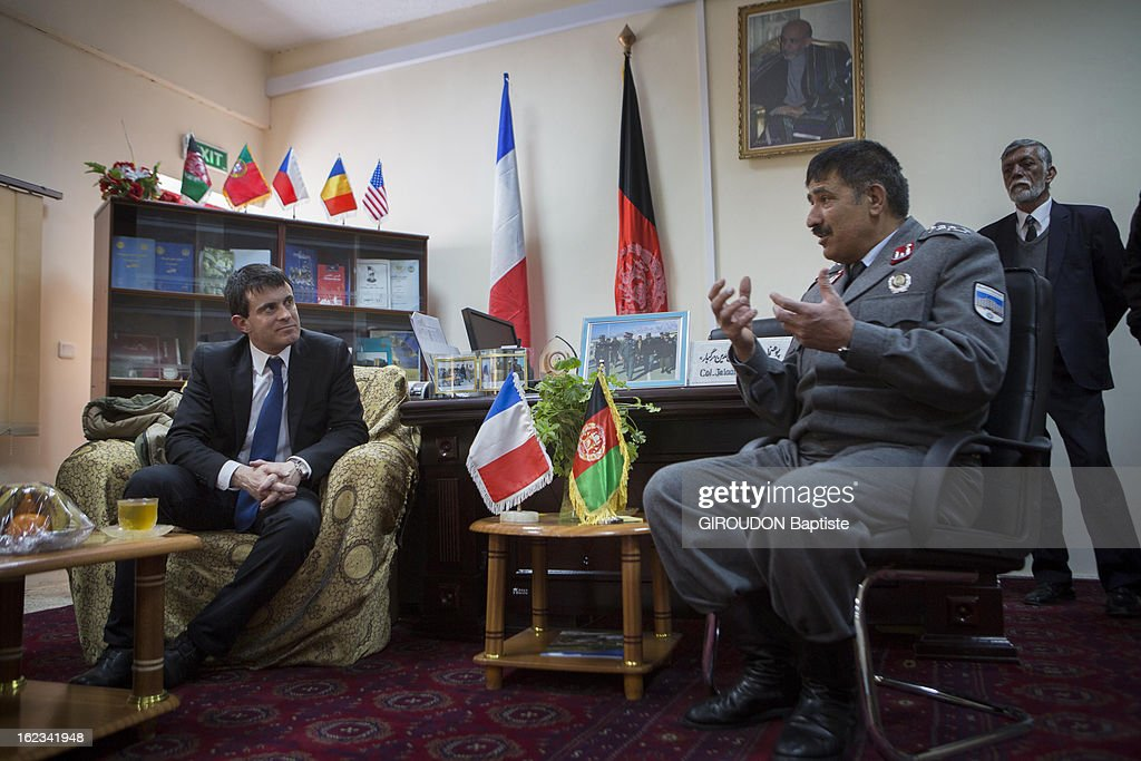 Manuel Valls, Minister of the Interior (L) meets Colonel Ragbar Jalaluddin (R) during his visit to the region on February 15, 2013 in Afghanistan.
