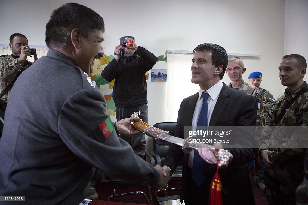 Manuel Valls, Minister of the Interior (R) meets Colonel Ragbar Jalaluddin (L) during his visit to the region on February 15, 2013 in Afghanistan.