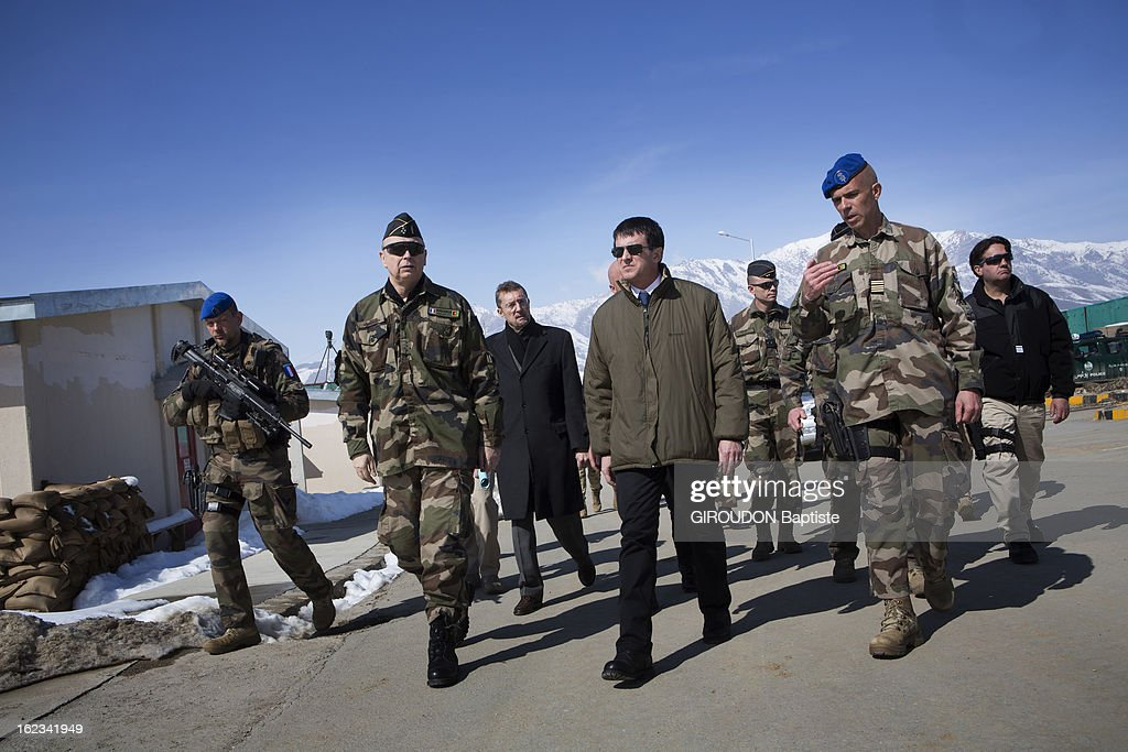 Manuel Valls, Minister of the Interior (C) with General Jacques Mignaux and French Ambassador Bernard Bajolet (3rdL),General Christian Dupouy, Colonel Jerome Delcambre during his visit to the region on February 15, 2013 in Afghanistan.