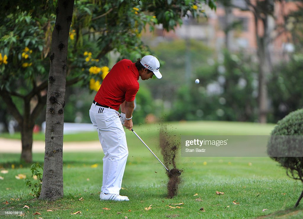 Manuel Villegas of Colombia hits from underneath a tree on the first hole during the final round of the Colombia Championship at Country Club de Bogota on March 3, 2013 in Bogota, Colombia.