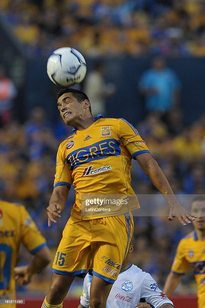 Manuel Viniegra of Tigres heads the ball during a match between Tigres UANL and Puebla FC as part of the Liga MX at Universitario stadium on September 21, 2013 in Monterrey, Mexico.