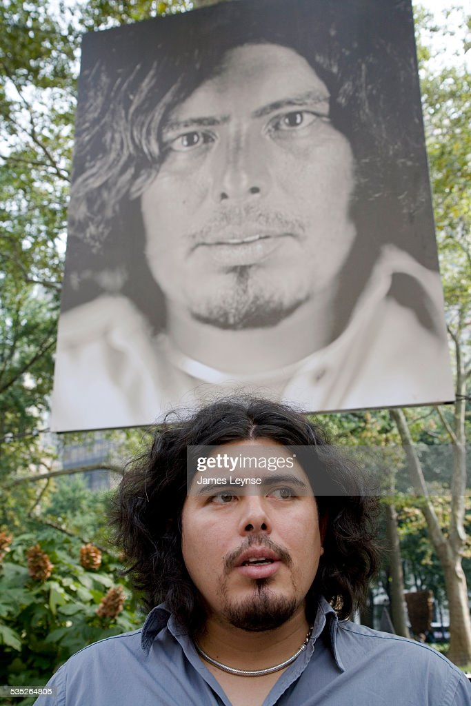 Manuel Vustamante a painter and Chuck Close's assistant stands in front of a a large print of a daguerreotype photo made of him by artist Chuck Close...