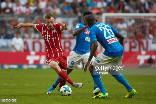 Manuel Wintzheimer of Bayern Muenchen and Kalidou Koulibaly of Napoli battle for the ball during the Audi Cup 2017 match between SSC Napoli and FC...