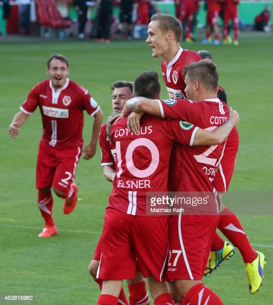 Manuel Zeitz of Cottbus jubilates with team mates after scoring the first goal after penalty during the DFB Cup match between FC Energie Cottbus and...