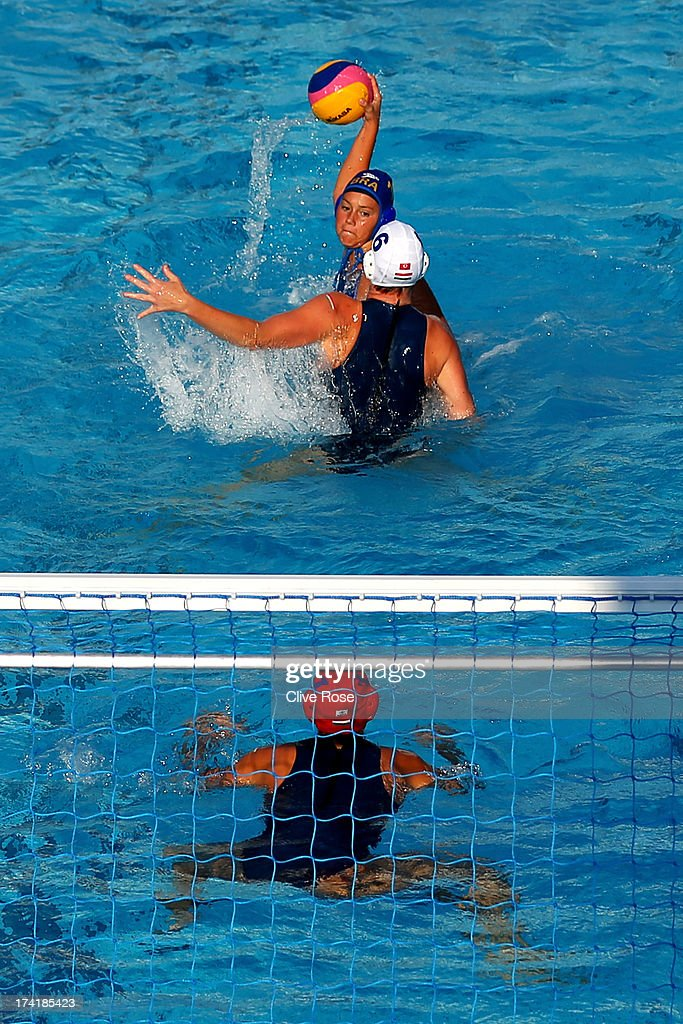 Manuela Canetti of Brazil looks to score a goal under pressure from captain Orsolya Takacs of Hungary during the Women's Water Polo first preliminary round match between Hungary and Brazil during Day Two of the 15th FINA World Championships at Piscines Bernat Picornell on July 21, 2013 in Barcelona, Spain.