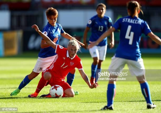 Manuela Giugliano of Italy and Ekaterina Pantyukhina of Russia compete for the ball during the Group B match between Italy and Russia during the UEFA...