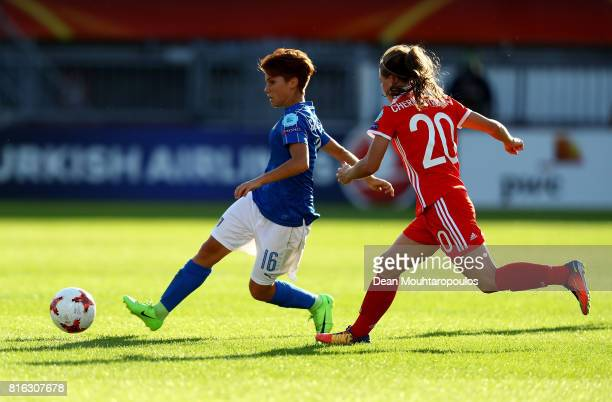 Manuela Giugliano of Italy and Margarita Chernomyrdina of Russia compete for the ball during the Group B match between Italy and Russia during the...