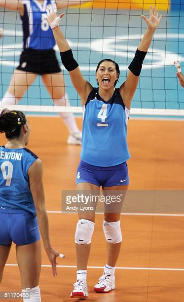 Manuela Leggeri of Italy celebrates after winning a point against Korea in the women's indoor Volleyball preliminary match on August 14 2004 during...