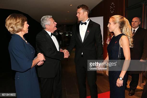 Manuela Schadt and Bundespraesident Joachim Gauck Manuel Neuer goal keeper FCBayern and his girlfriend Nina Weiss during the 23rd Opera Gala benefit...