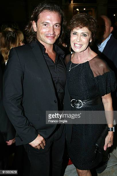 Manuele Malenotti and actress Corinne Clery attend the Audi A3 Cabriolet Style by Belstaff party presented by Belstaff at the Belstaff store on...