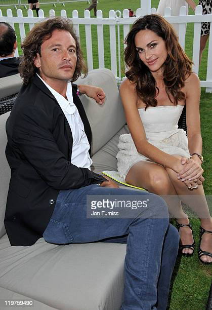 Manuele Malenotti and Tasha De Vasconcelos attends the Cartier International Polo Day 2011 at Guards Polo Club in Windsor Great Park on July 24 2011...
